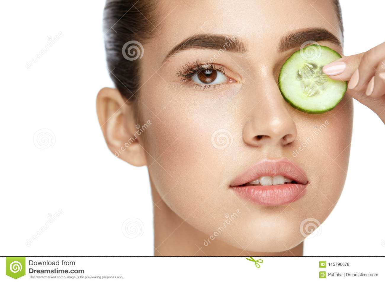 Girl using cucumber