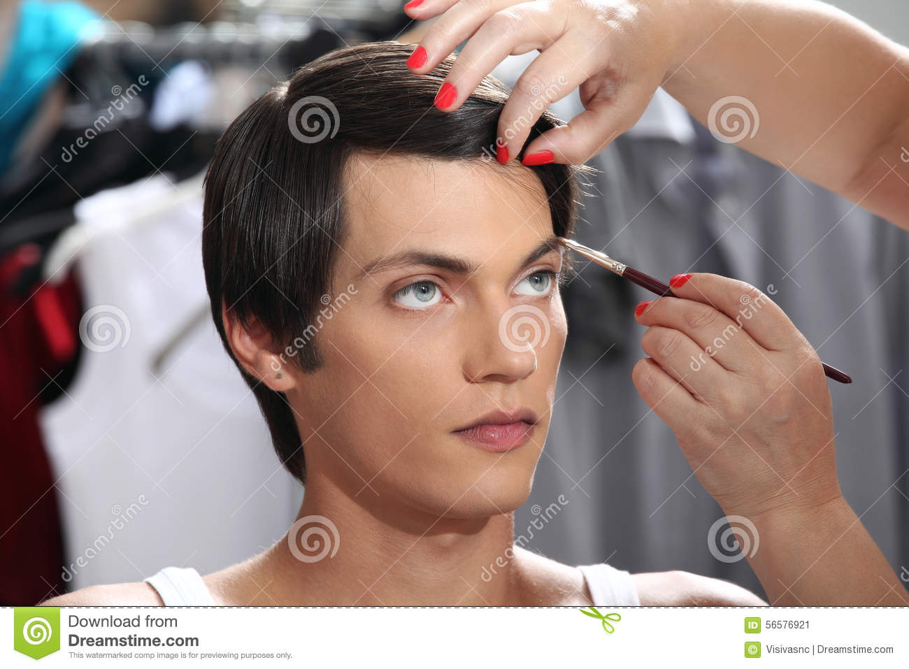 Eyebrows With Makeup Brush Model At Mirror In Dressing Room Stock
