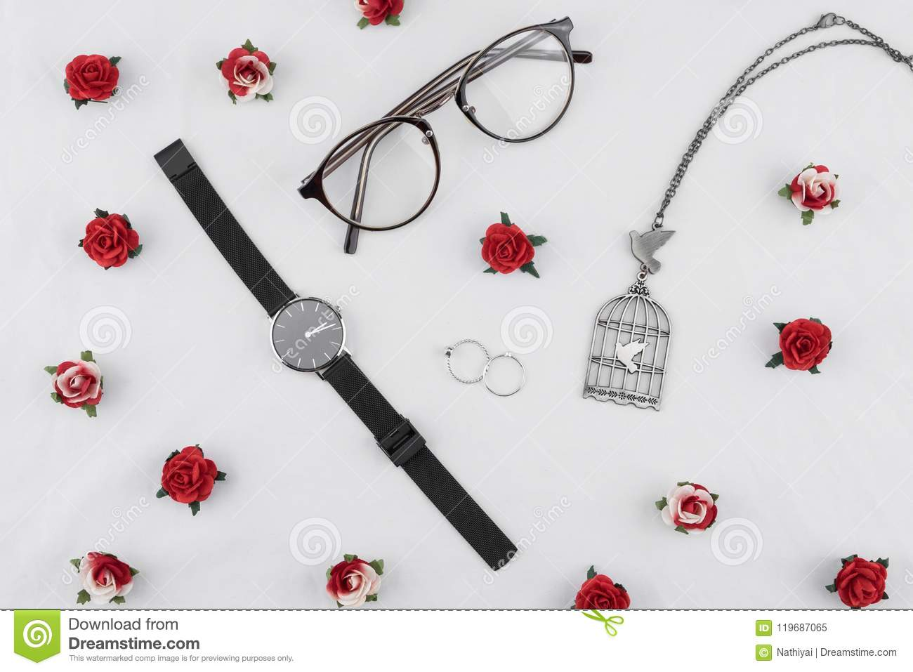 Eyeglasses, black watches, necklace and rings