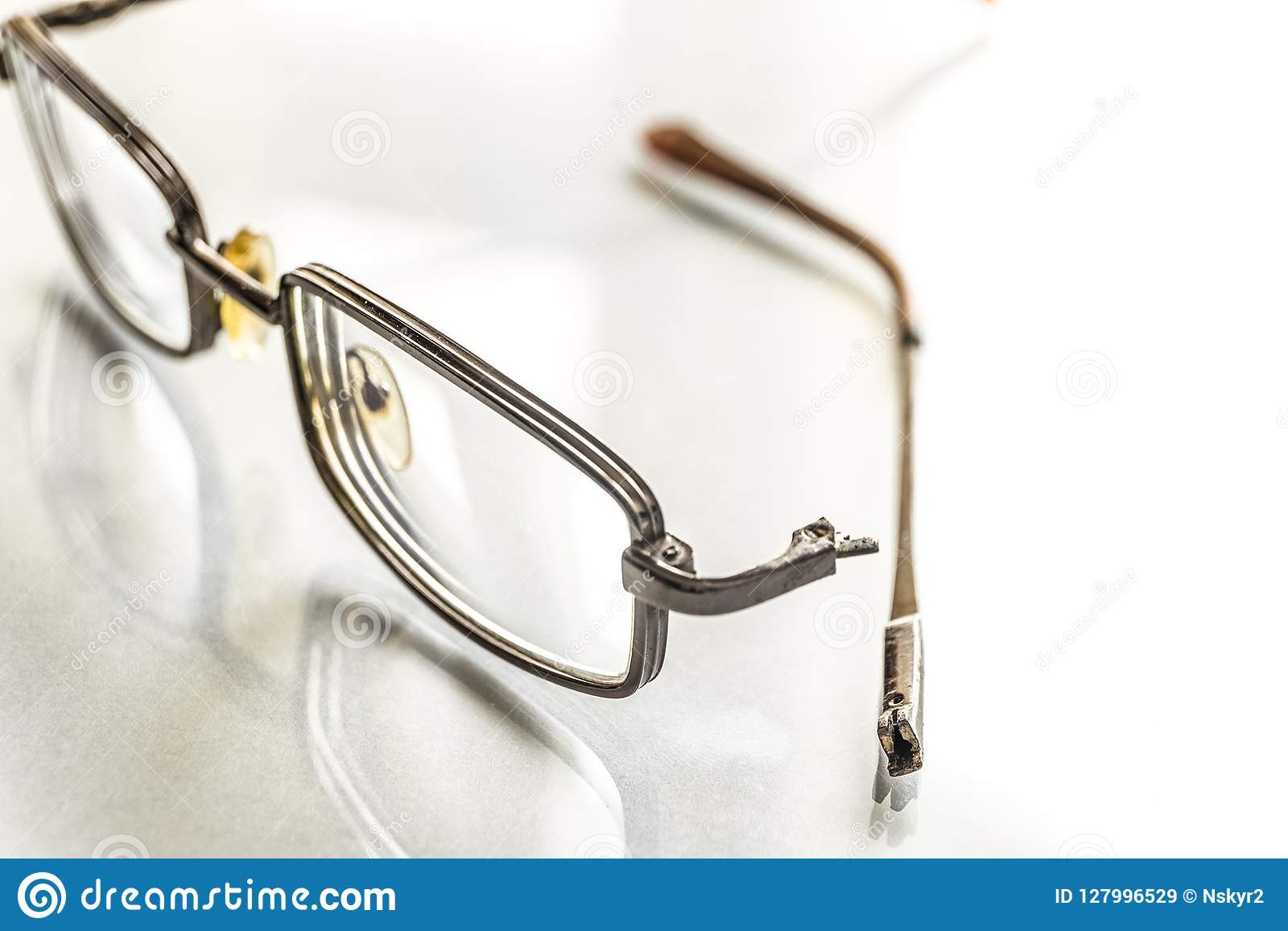 Eyeglasses With A Broken Shackle On A Bright Background