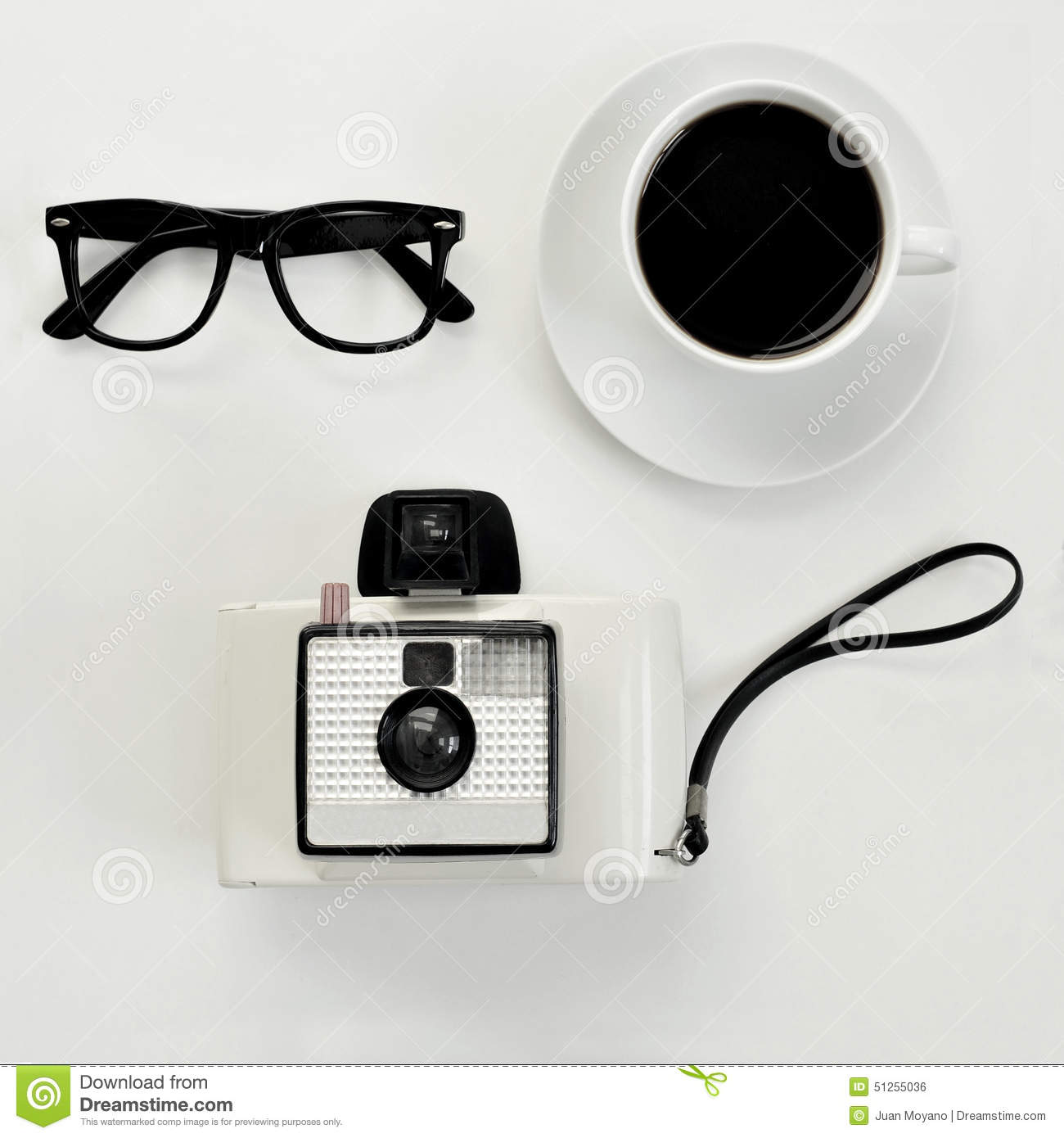 Eyeglasses, Coffee And Instant Camera Stock Photo