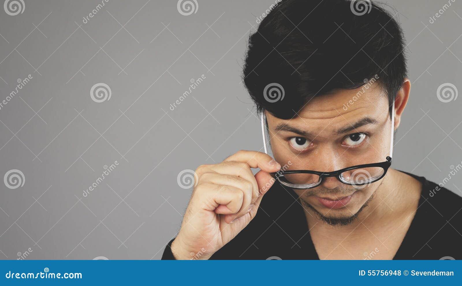 An eyeglasses guy looking at camera.