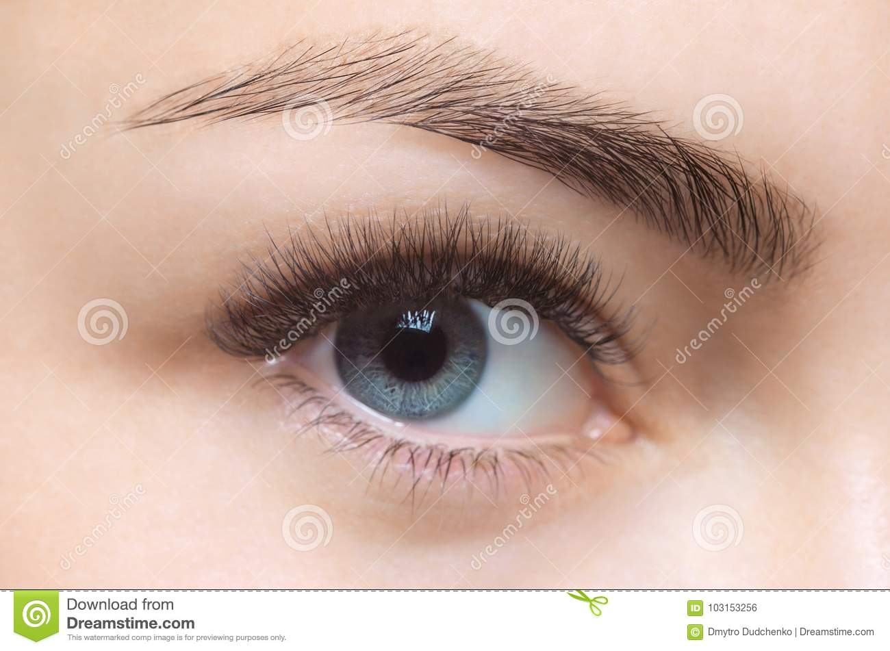 Eyelash removal procedure close up. Beautiful Woman with long lashes