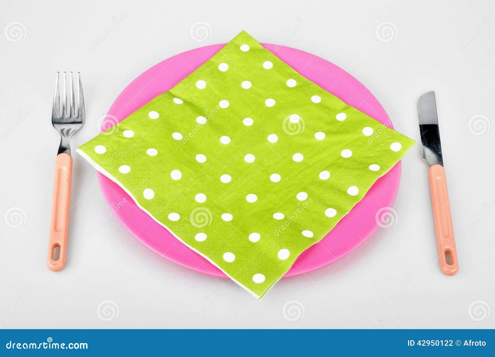 Färgrik platta och servett
