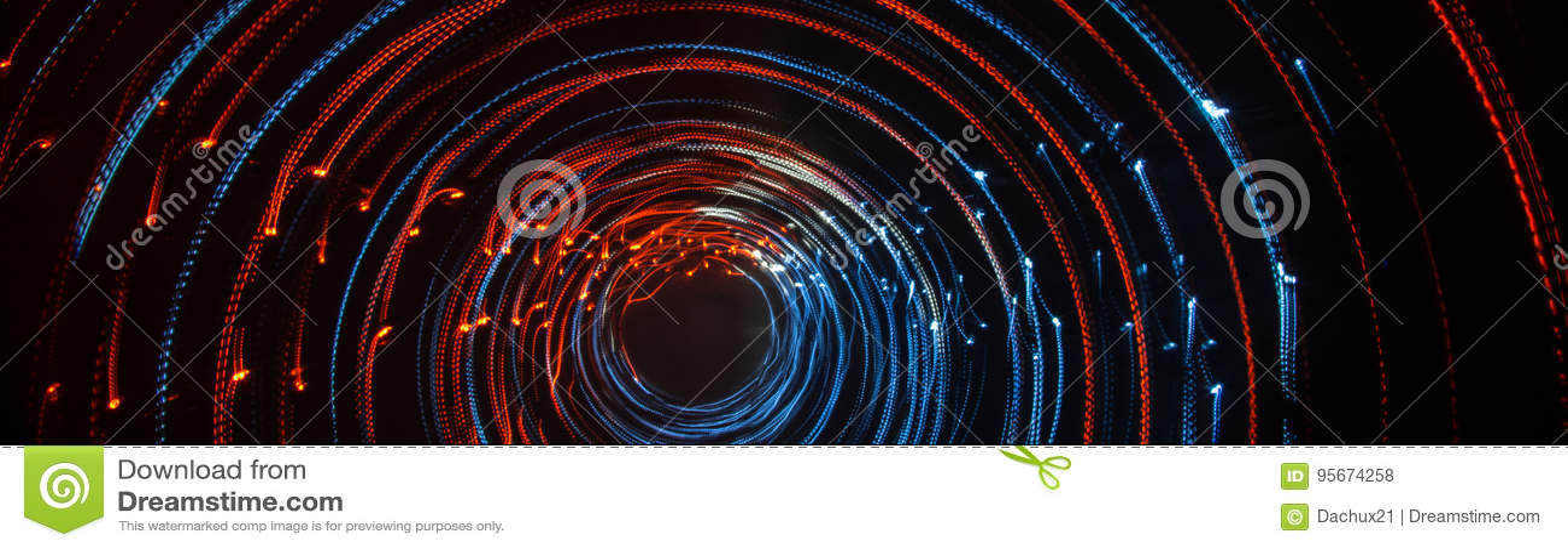 Färgrika abstrakta slingor av ljus Prickar, linjer och bokeh på mörk bakgrund