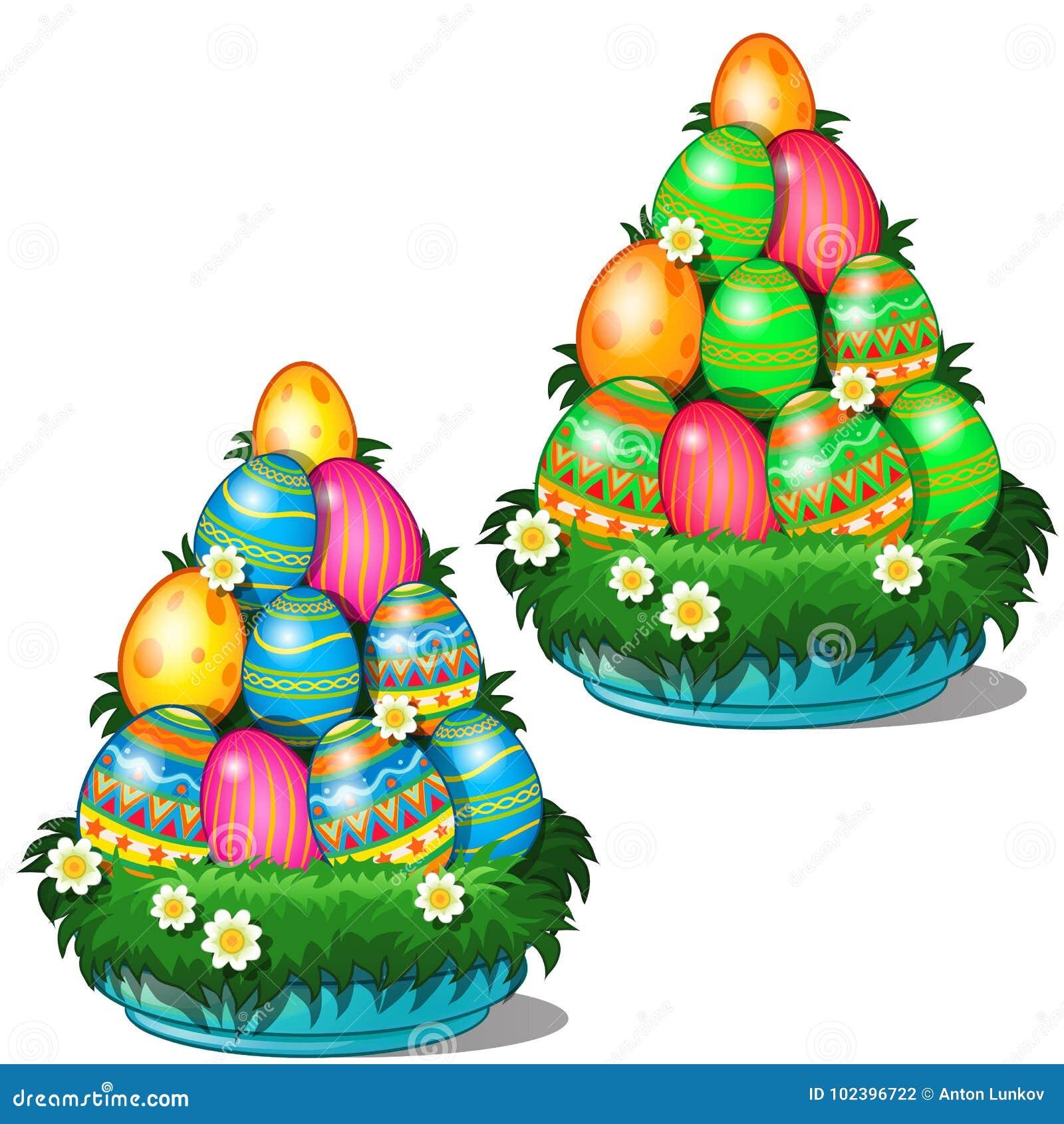 Färgrika påskägg med olika modeller som staplas i kotte på plattan med gräs och blommor Symbol för ferie