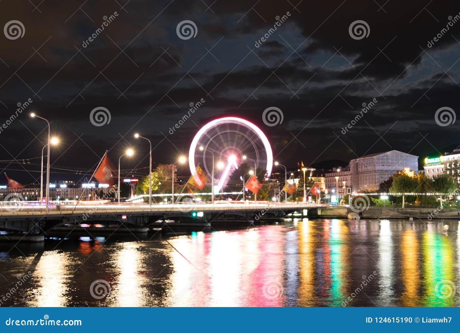 För geneva Schweiz för stort hjul suddighet för exponering för reflexion för natt ljus lång