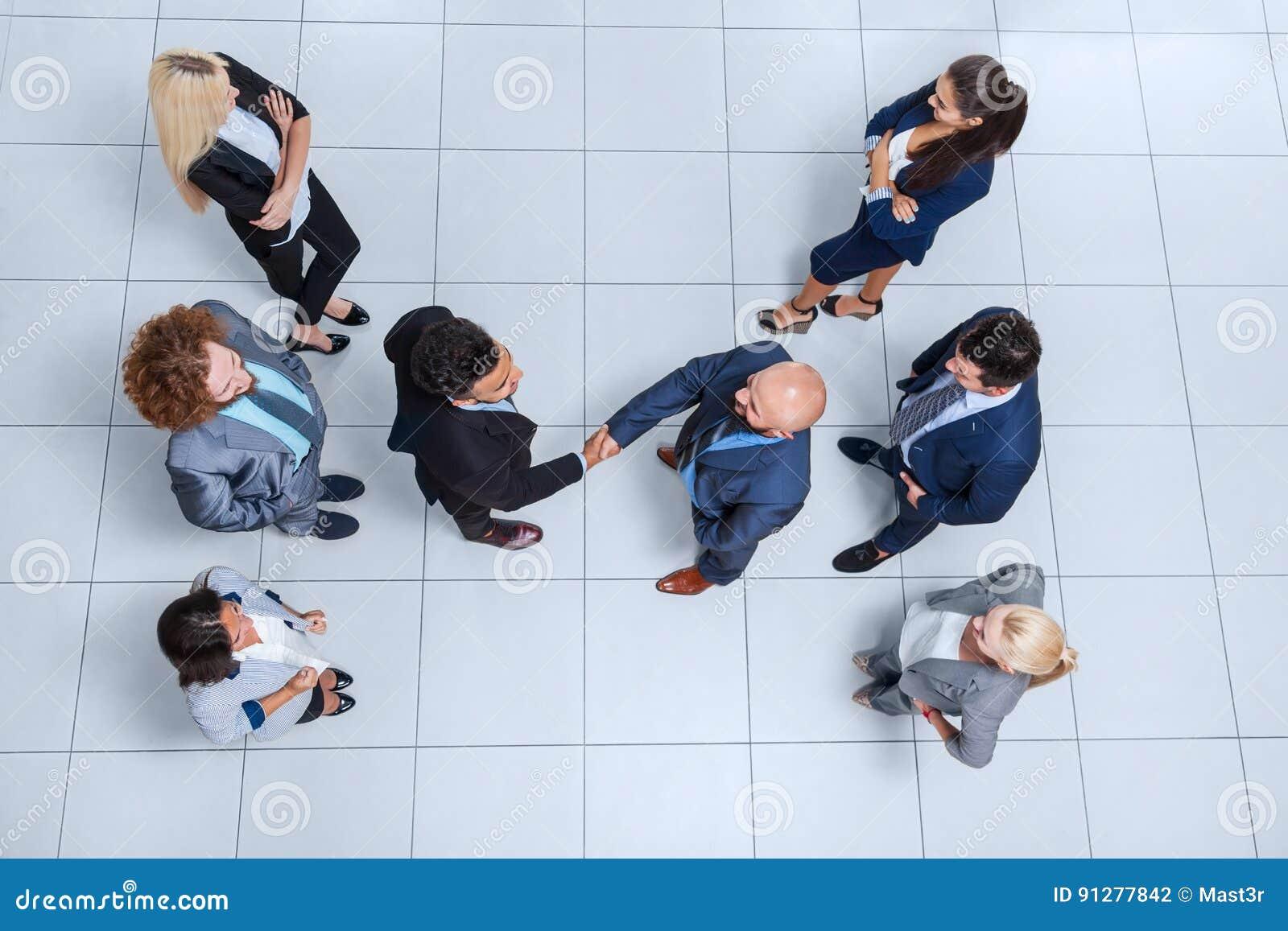 För Hand Shake Welcome för framstickande för grupp för affärsfolk sikt för bästa vinkel gest, Businesspeople Team Handshake