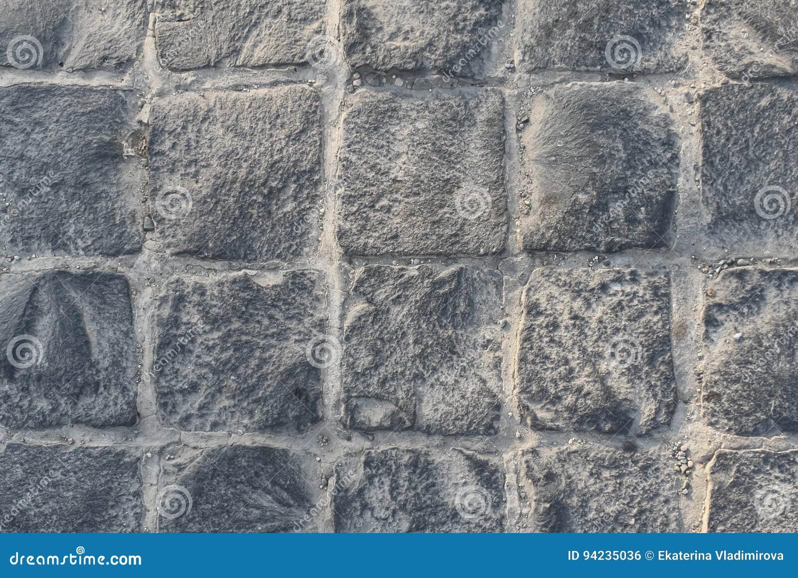 Förberedande textur för sten Göra sammandrag strukturerad bakgrund av den moderna modellen för gatatrottoartjock skiva