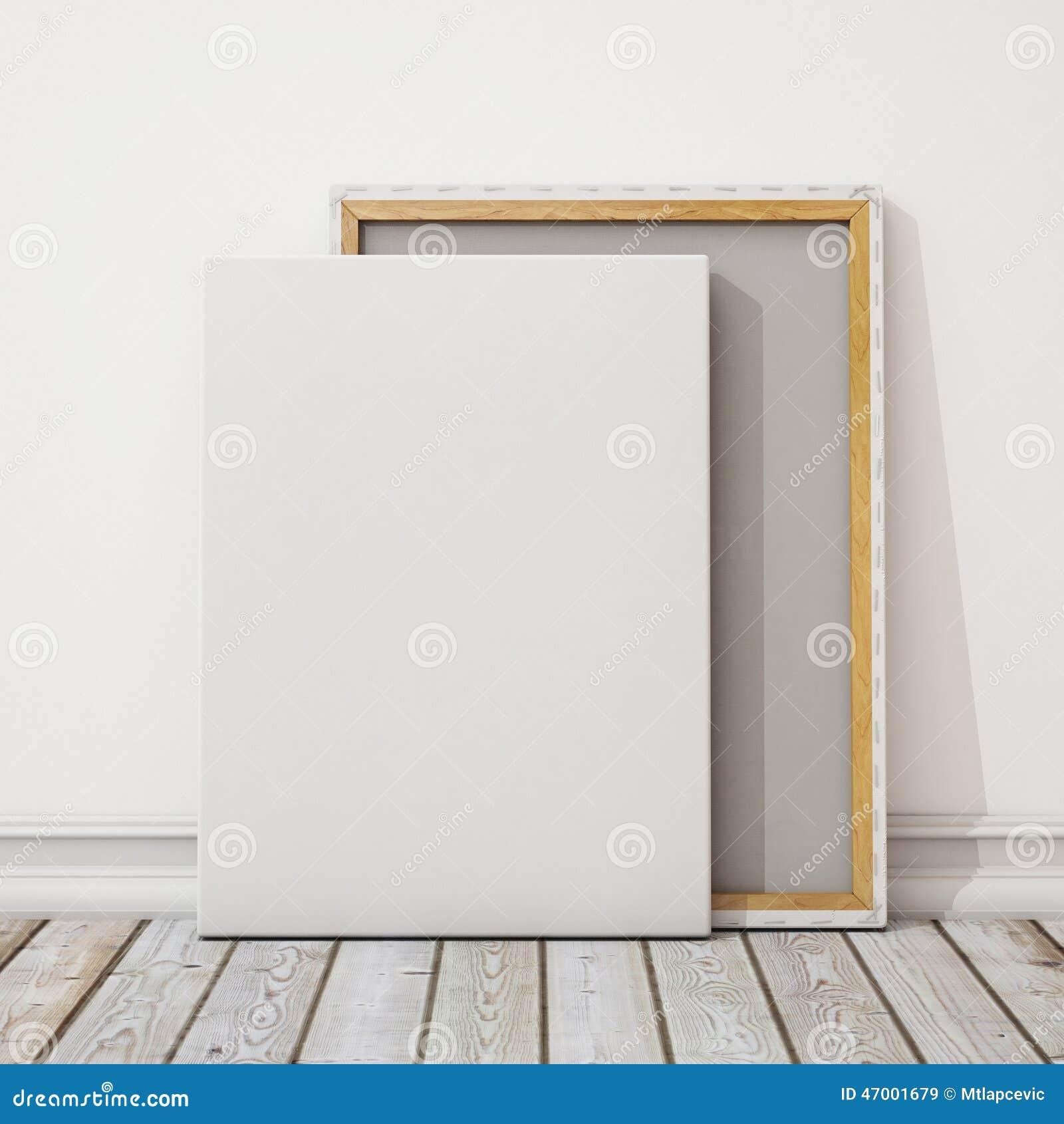 Förlöjliga upp tom kanfas eller affischen med högen av kanfas på golvet och väggen, bakgrund
