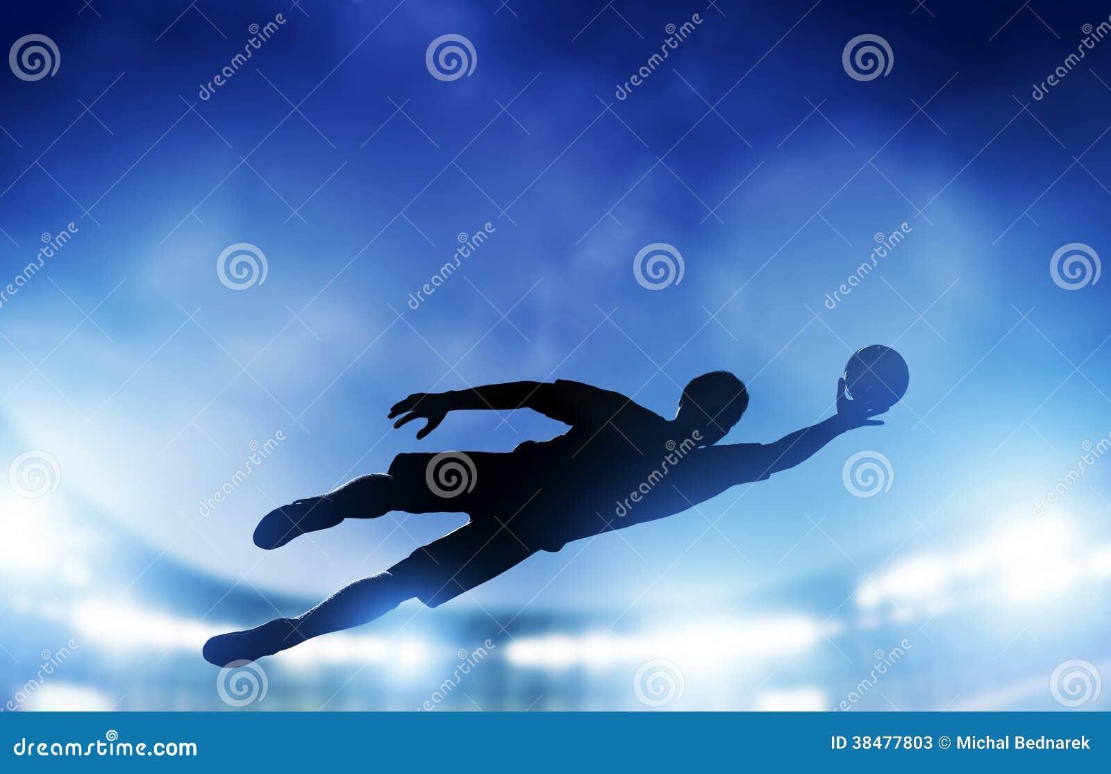 Fútbol, partido de fútbol. Un portero que salta ahorrando la bola de meta