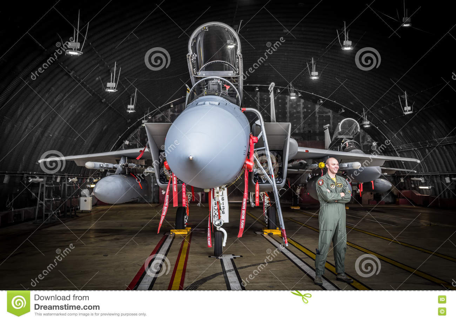 F15 fighter jet pilot in hangar