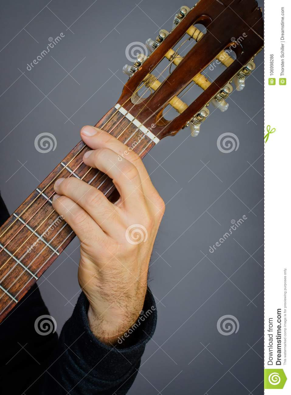 F Minor Chord Played By Guitarist On Classical Acoustic Guitar Stock