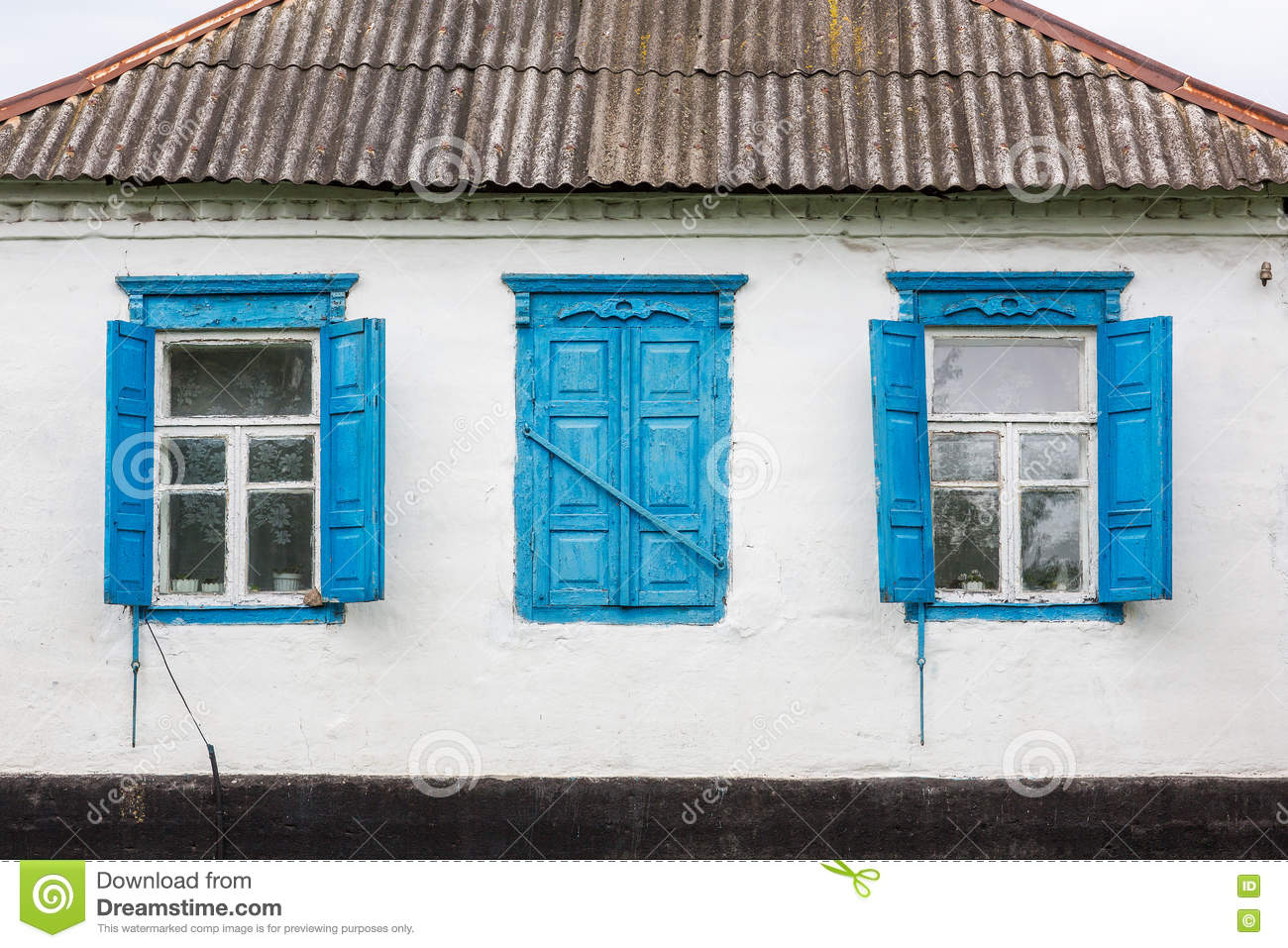 Faсade old hous with windows.