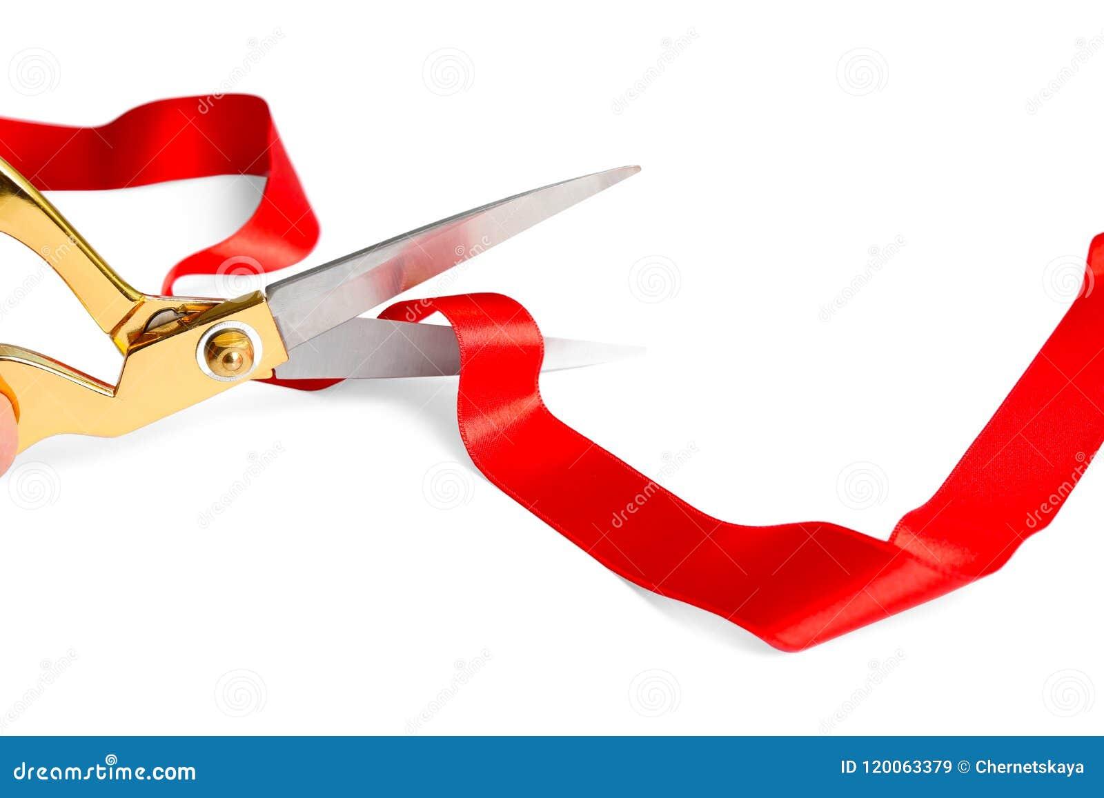 Faborek i nożyce na białym tle Ceremonialny czerwonej taśmy rozcięcie