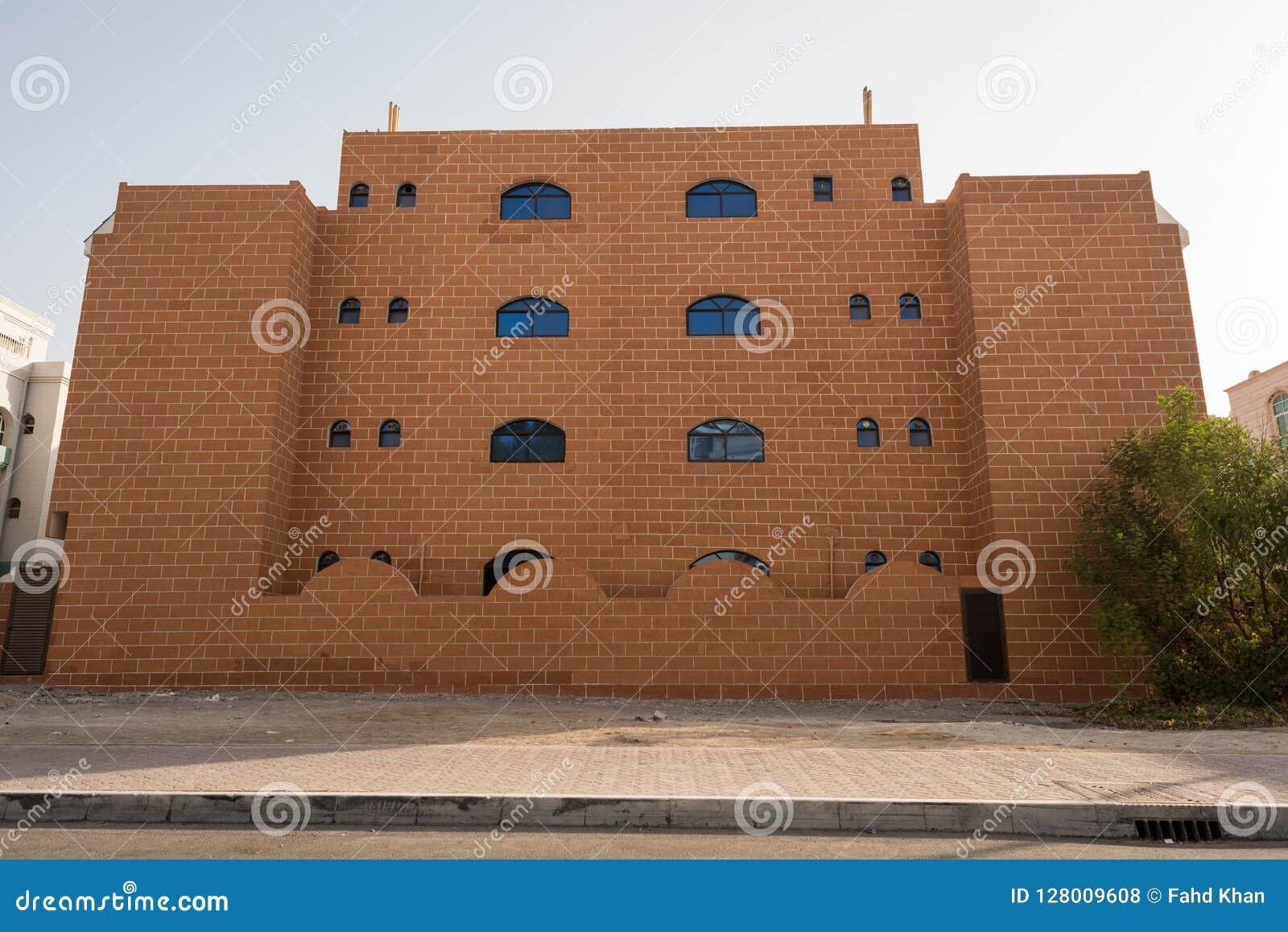 Facade of a Brown villa made of brown bricks like tiles