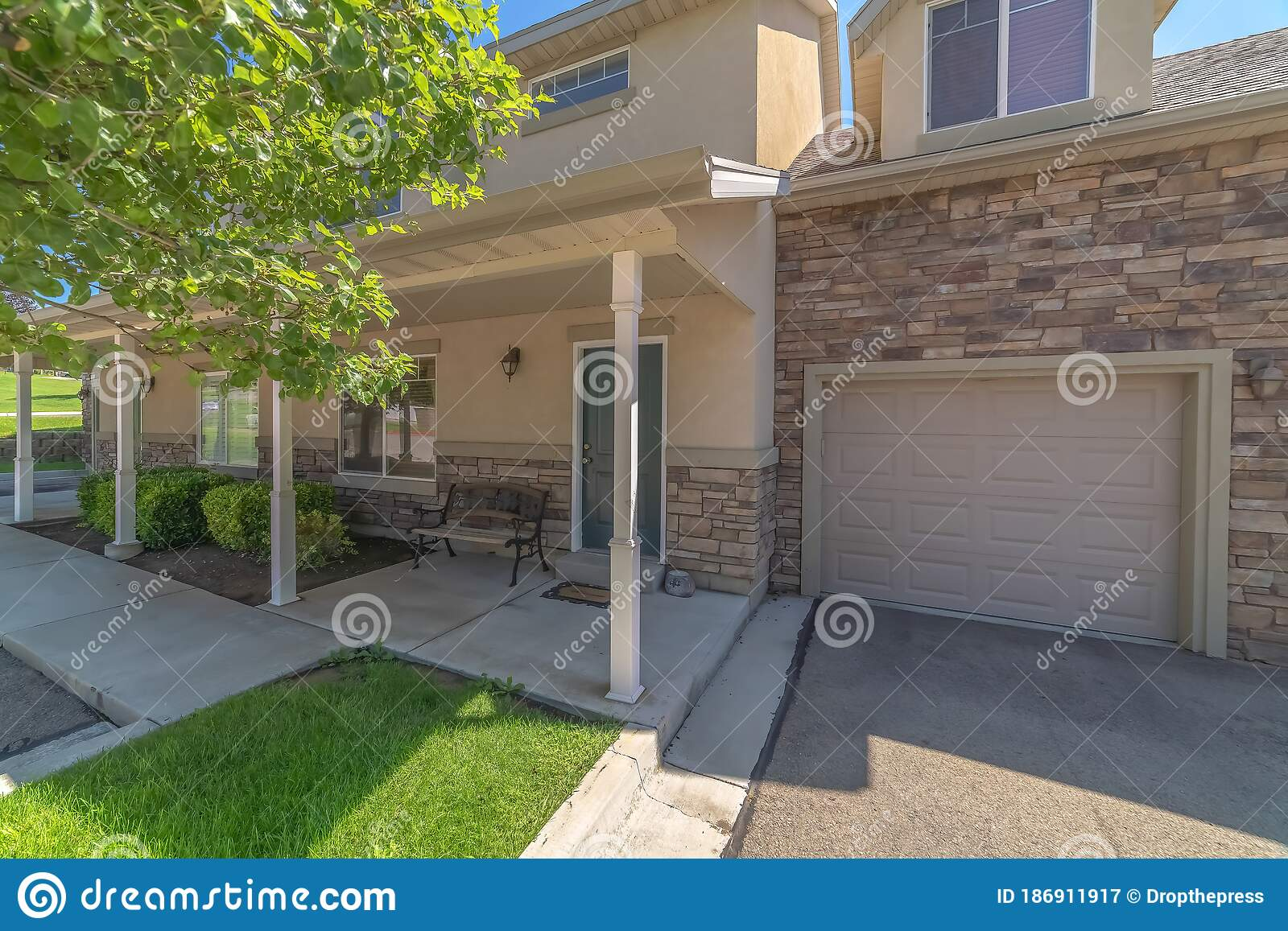 Facade Of Home With Panelled Front And Garage Doors Small Porch And Dormer Stock Image Image Of Dormer Exterior 186911917