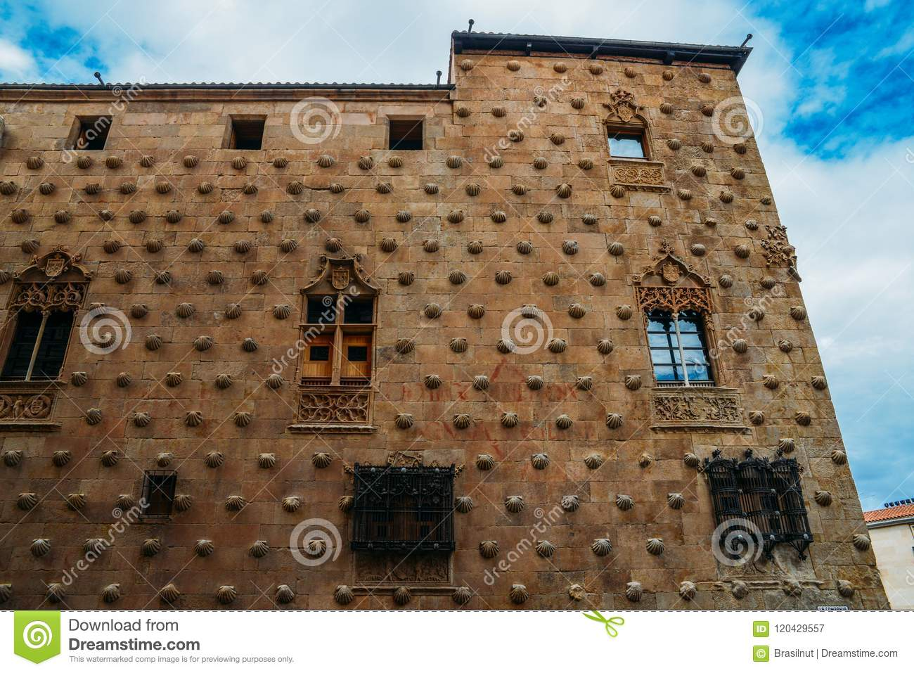 Facade to 16th-century Gothic palace covered in symbolic seashell motifs, now an exhibition space library, Salamanca
