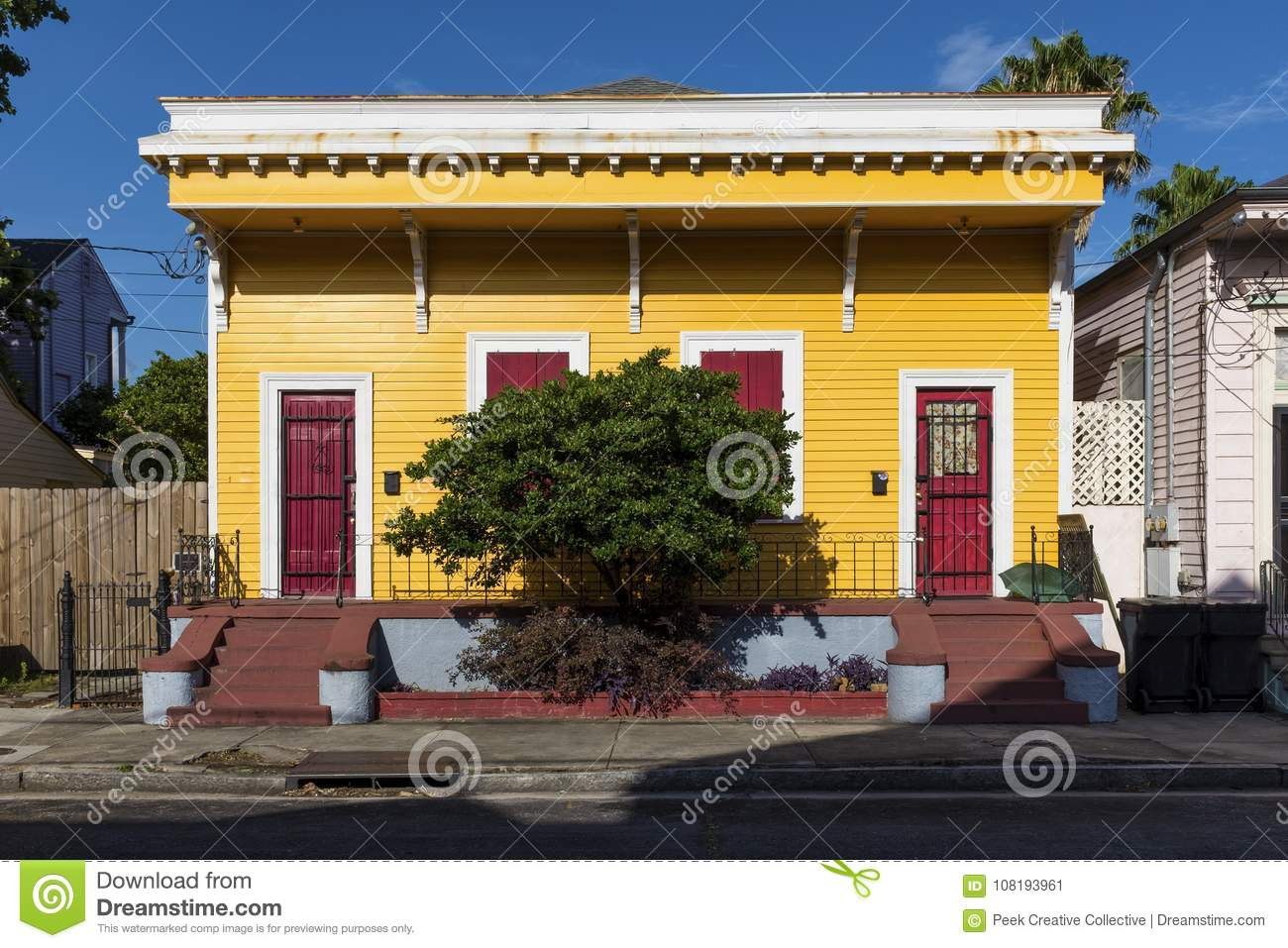 The facade of a traditional colorful house in the Marigny neighborhood in the city of New Orleans, Louisiana