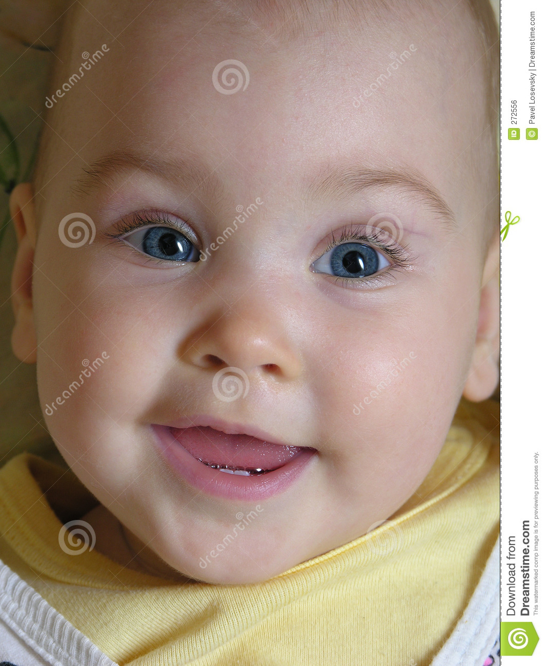 Face baby smile with two teeths