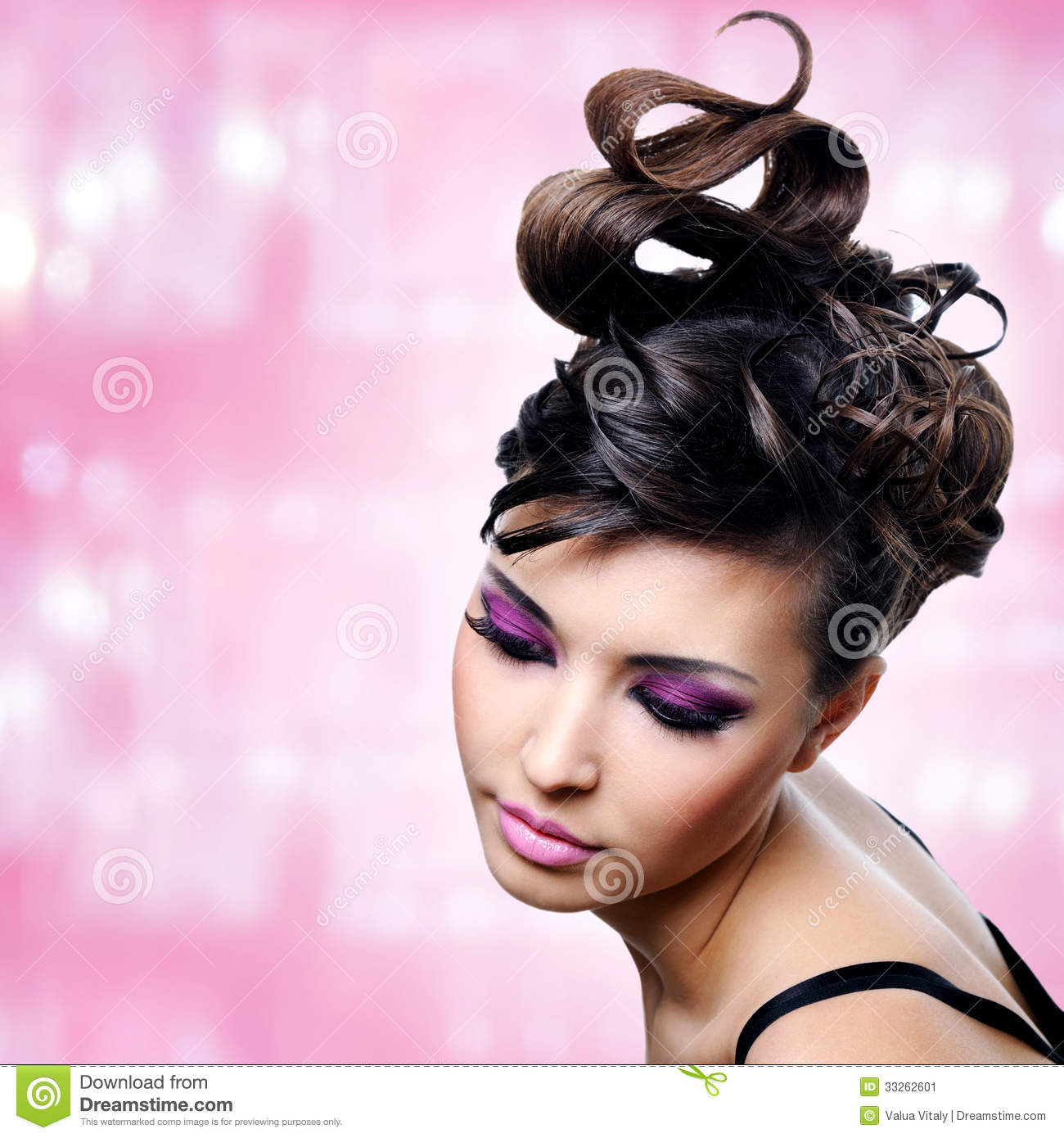 Face of beautiful woman with fashion hairstyle and glamour makeup