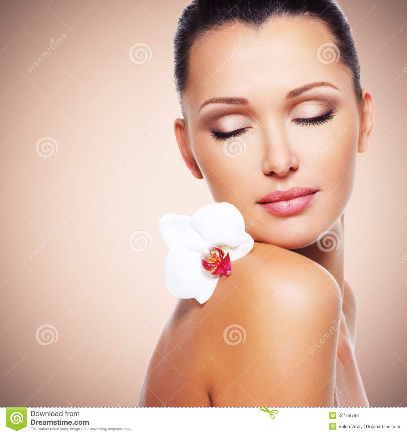 Beautiful Skin Care: Face Of Beautiful Woman With A White Orchid Flower Stock