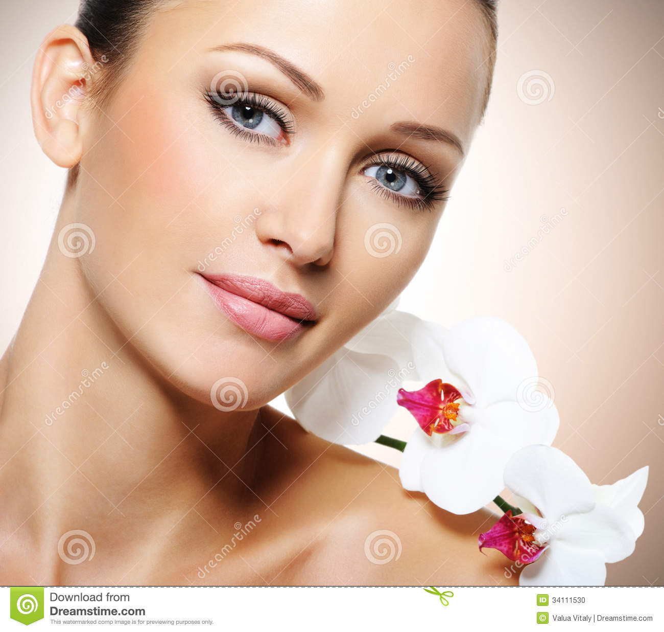 Woman Skin Care: Face Of Beautiful Woman With A White Orchid Flower Stock