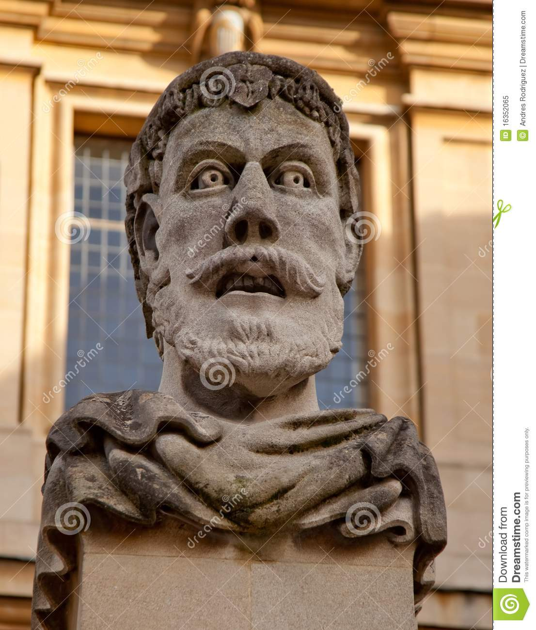 Face carved in stone royalty free stock photo image