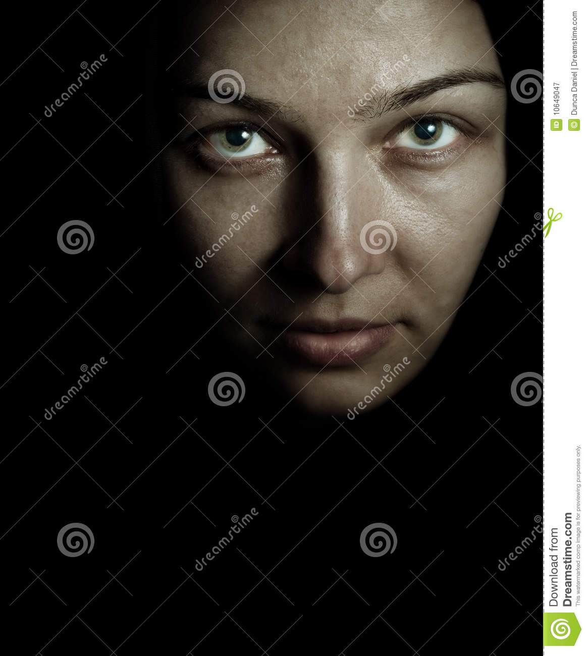 Face and eyes of spooky mystery woman in the dark - face-eyes-spooky-mystery-woman-dark-10649047