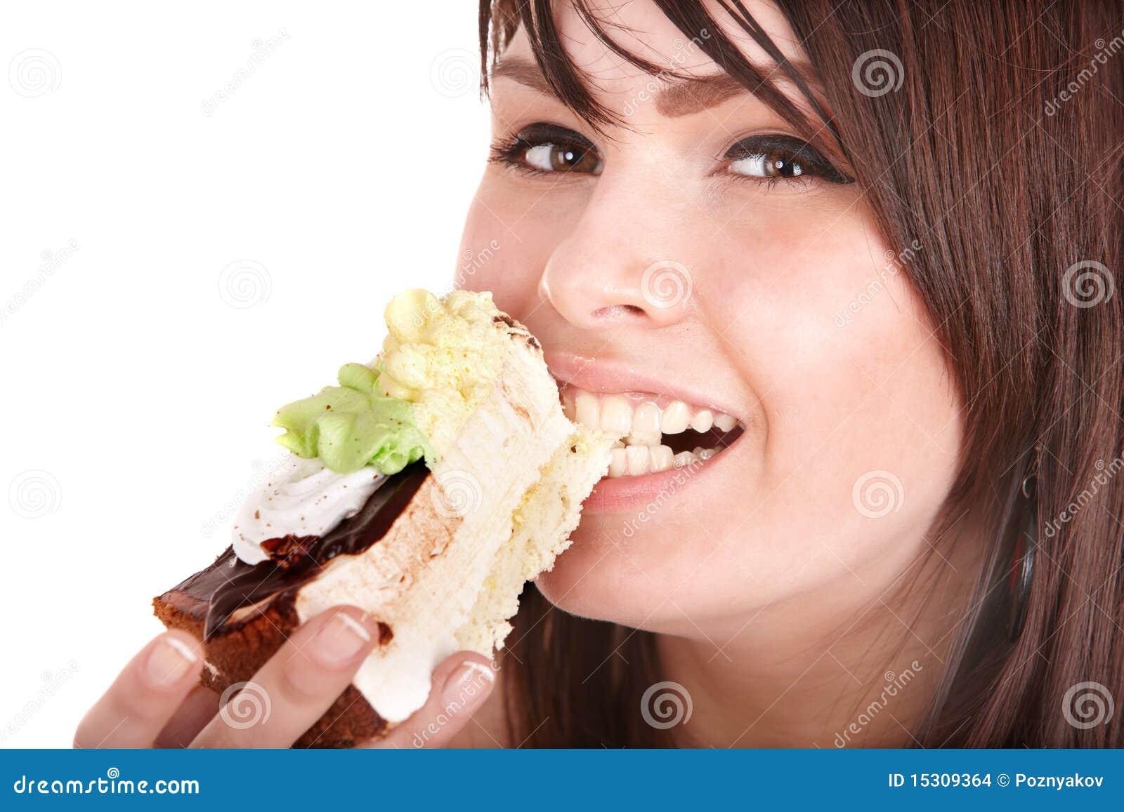 Face of girl eating cake.