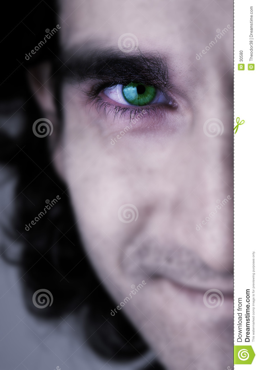 Face and green eye