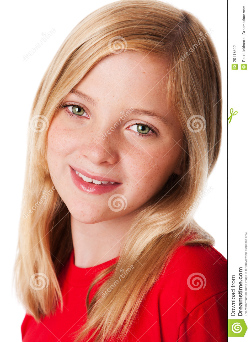 Beautiful face of a happy smiling teenager child girl with green eyes ...