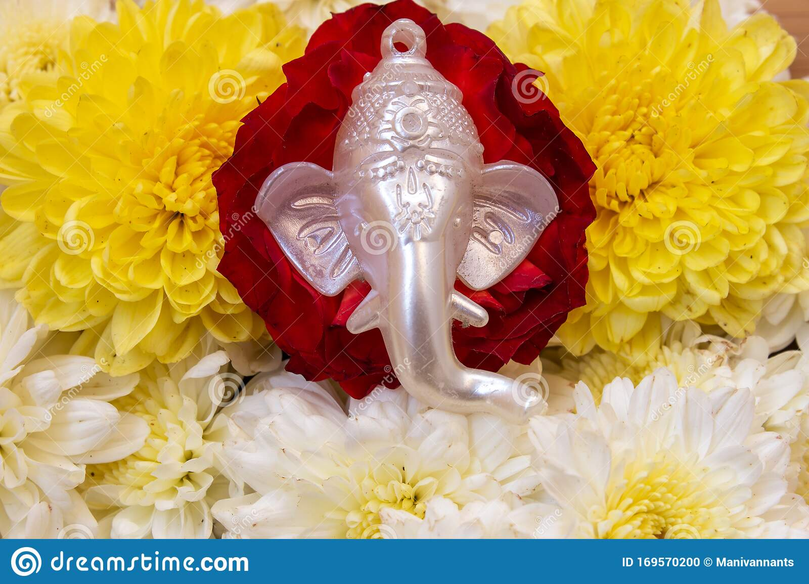 Face Lord Ganesha Placed Over Beautiful Rose And