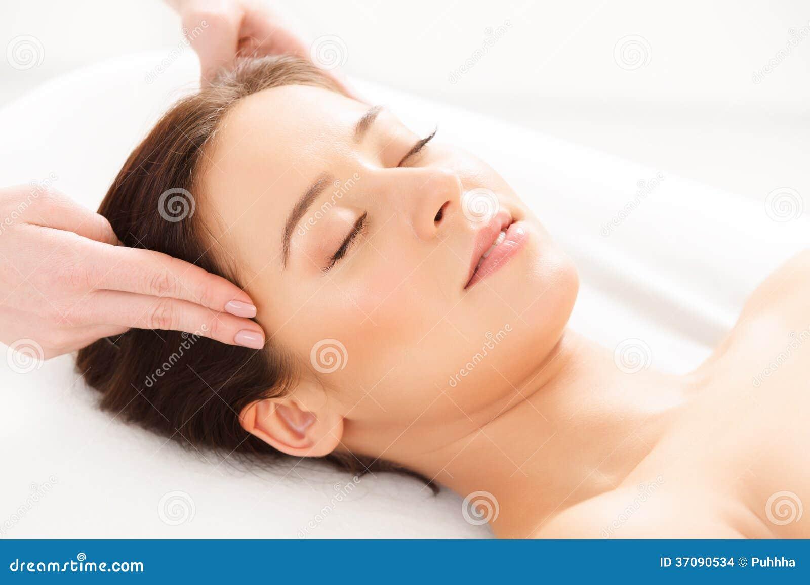 naked woman getting massage