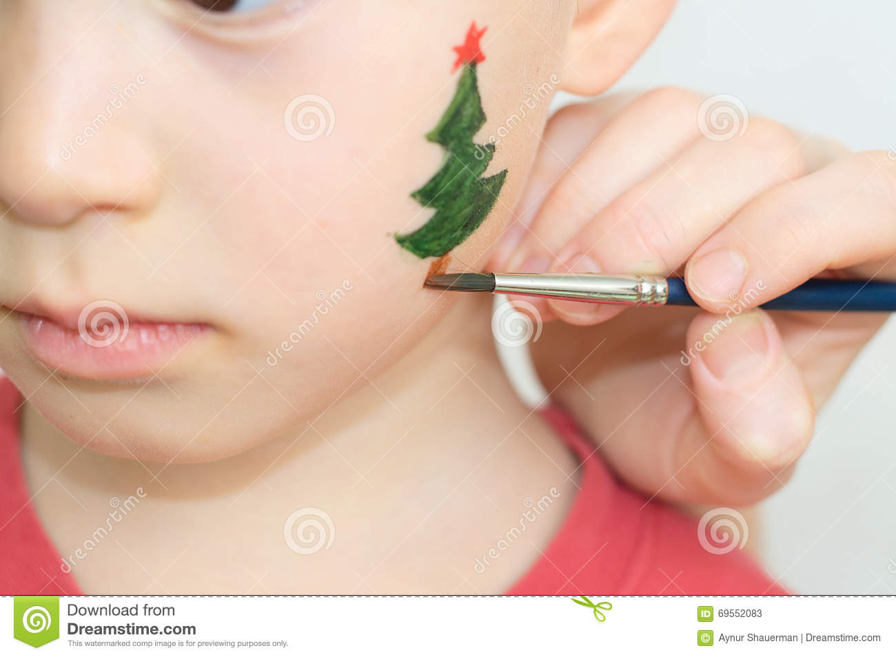 Christmas Face Paint.Face Painting Of Firtree For Christmas Party Stock Image