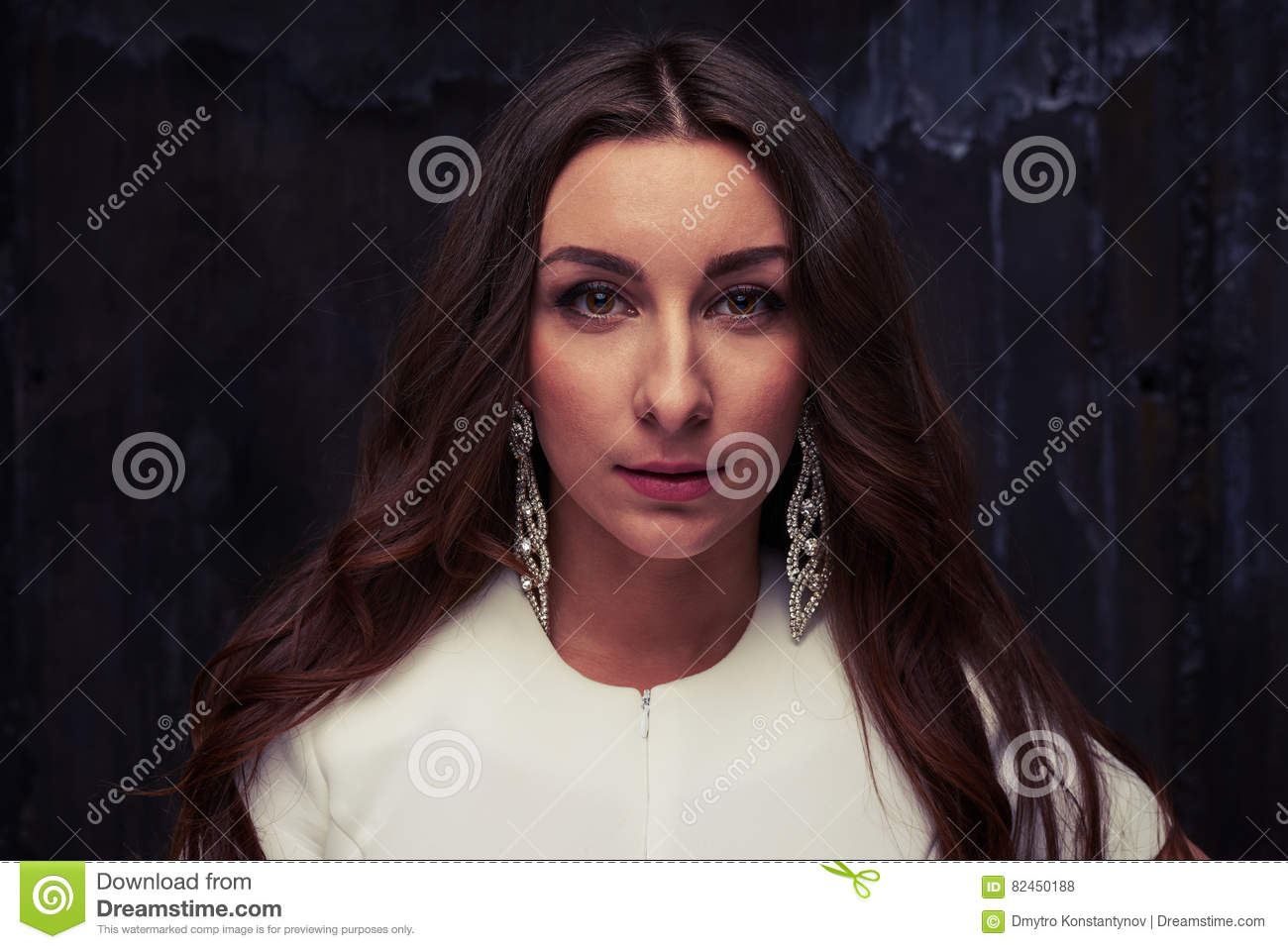 Face portrait of an attractive brunette with chestnut eyes and