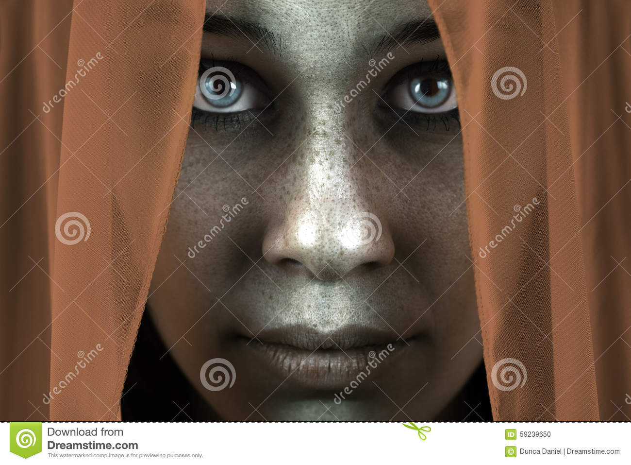 Face of shy freckled woman with beautiful big eyes