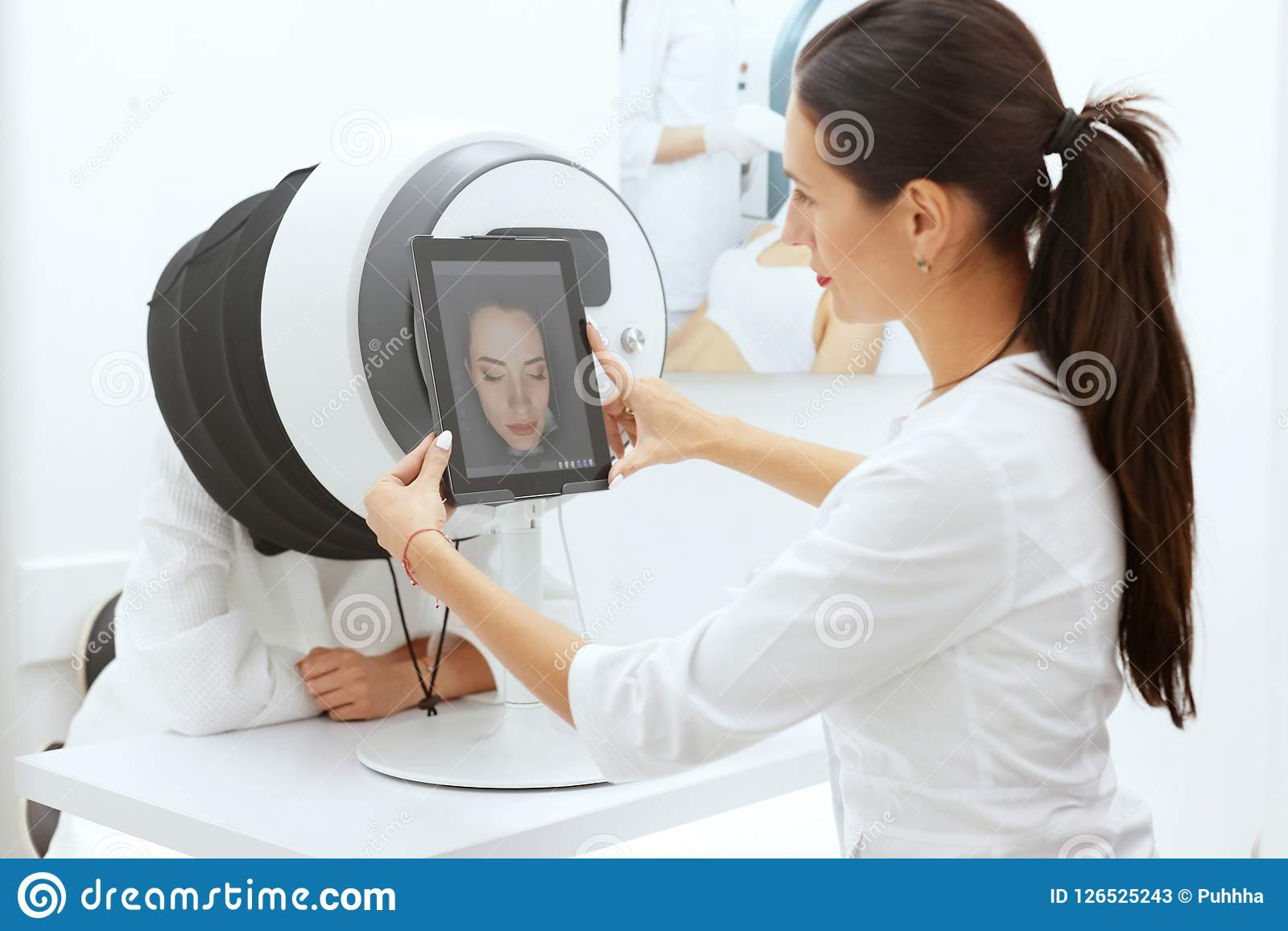 Face Skin Analysis. Woman At Cosmetology Doing Skin Diagnostic