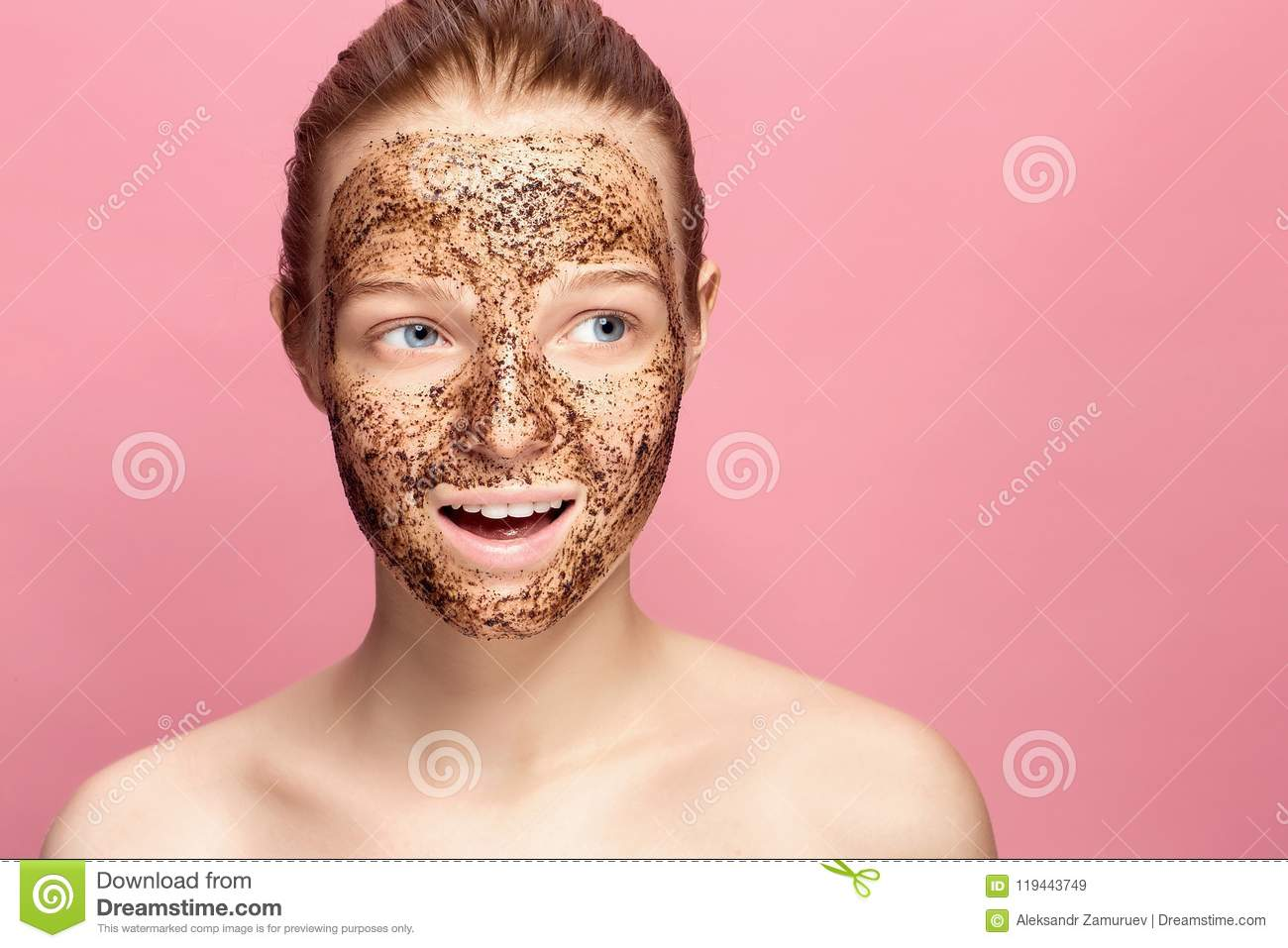 Face Skin Scrub. Portrait Of Smiling Female Model Applying Natural Coffee Mask, Face Scrub On Facial Skin. Closeup
