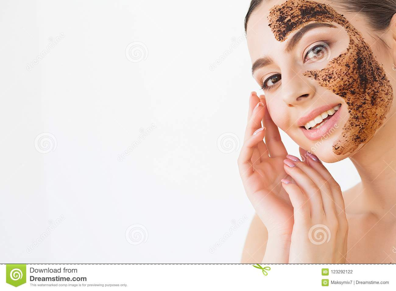 Face Skincare. Young charming girl makes a black charcoal mask o
