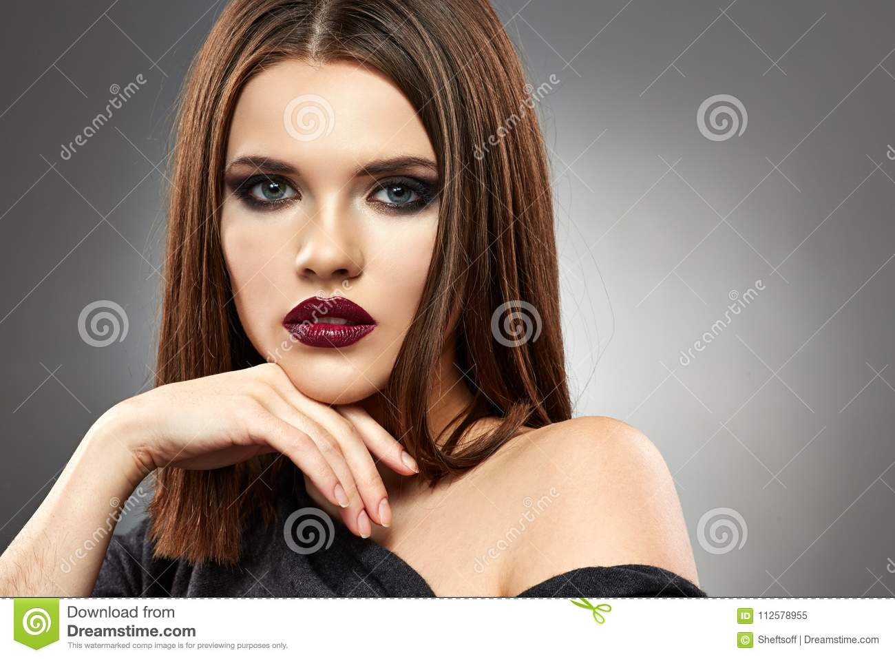 Young Woman With Long Ginger Hair Looking Up Head And