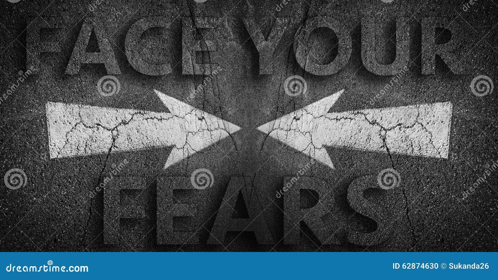 Face you fears written on road