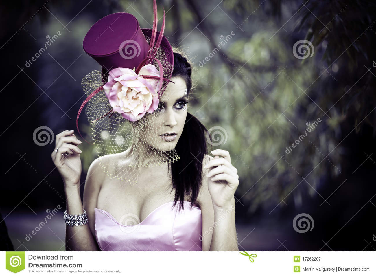 Face of young beautiful woman in a vintage hat