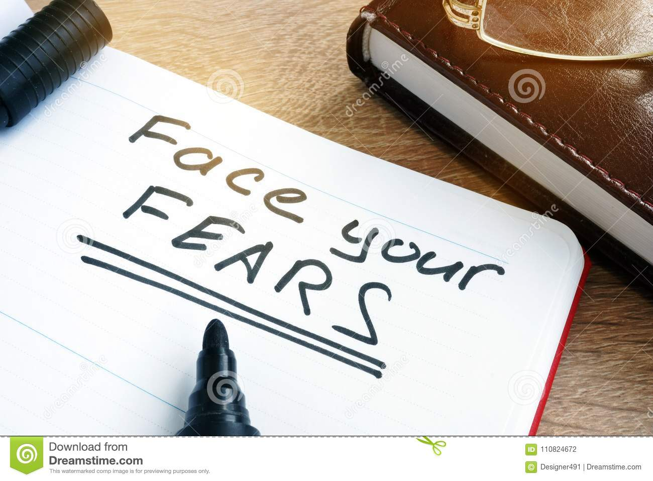 Face your fears written in a note.