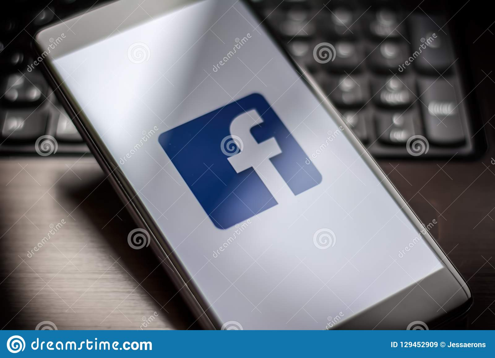 Facebook page on the smartphone on table