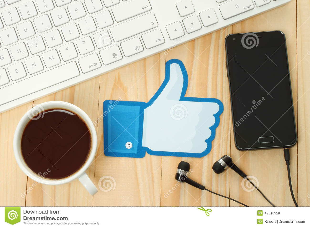Facebook thumbs up sign printed on paper and placed on wooden background