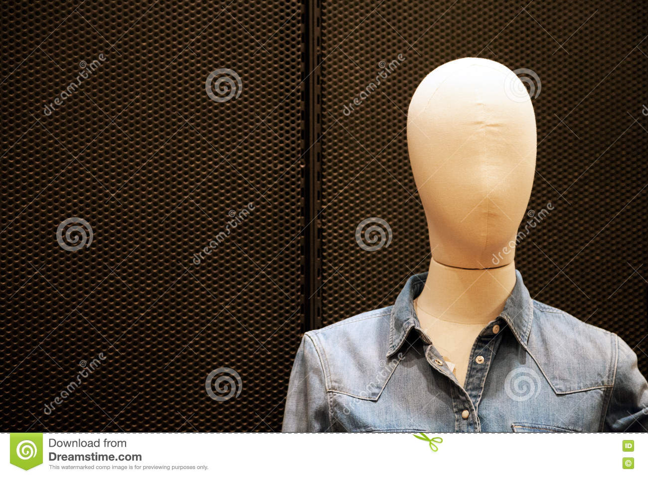 Faceless female mannequin wearing cheap casual jean jacket at shopping mall