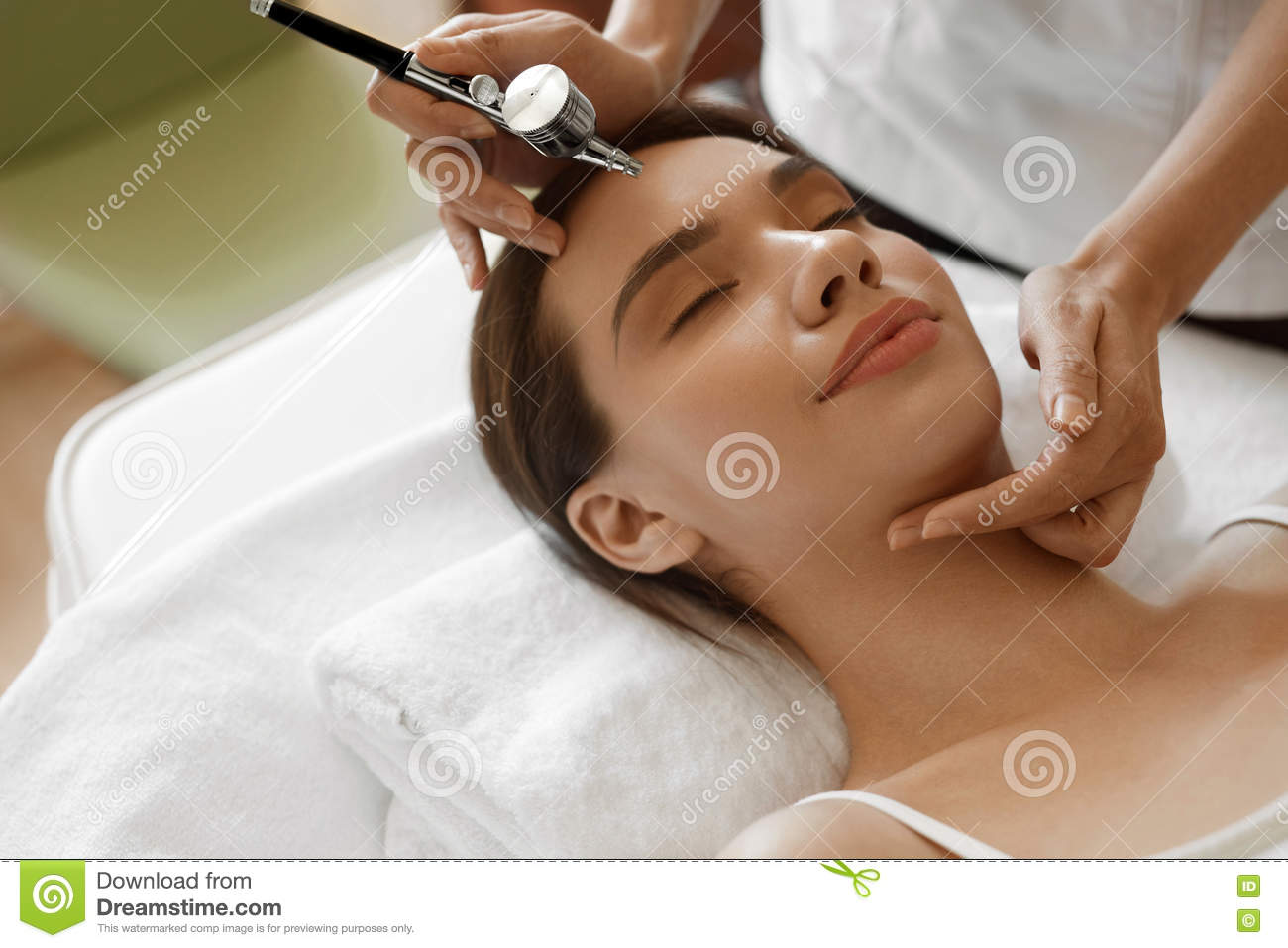 Facial Beauty Treatment. Woman Getting Oxygen Skin Peeling