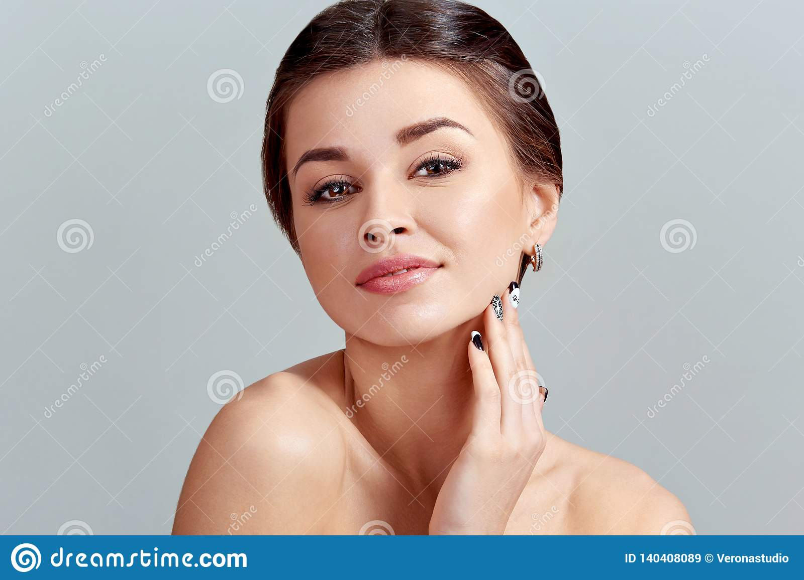 Facial Care. Female Applying Cream and Smiling. Beauty Face. Portrait Of Young Woman.