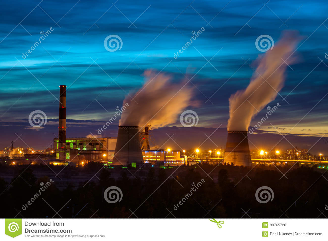 Factories at night, the silhouettes of the pipe producing a noxious smoke into the sky..